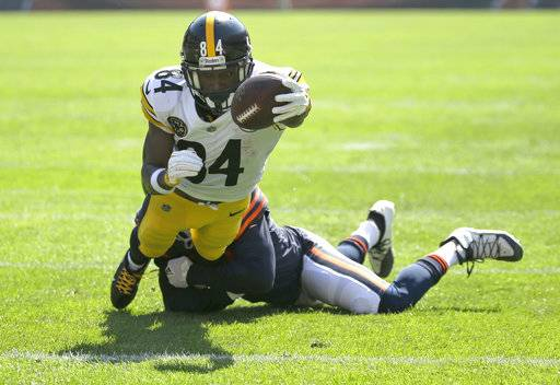 Pittsburgh Steelers wide receiver Antonio Brown (84) dives into the end zone for a touchdown past a Chicago Bears defender during the first half of an NFL football game against the Chicago Bears, Sunday, Sept. 24, 2017, in Chicago.