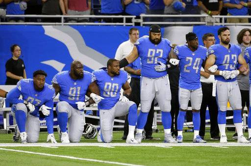 Detroit Lions defensive end Armonty Bryant (97), defensive tackle A'Shawn Robinson (91) and defensive end Cornelius Washington (90) take a knee during the national anthem before an NFL football game against the Atlanta Falcons, Sunday, Sept. 24, 2017, in Detroit.