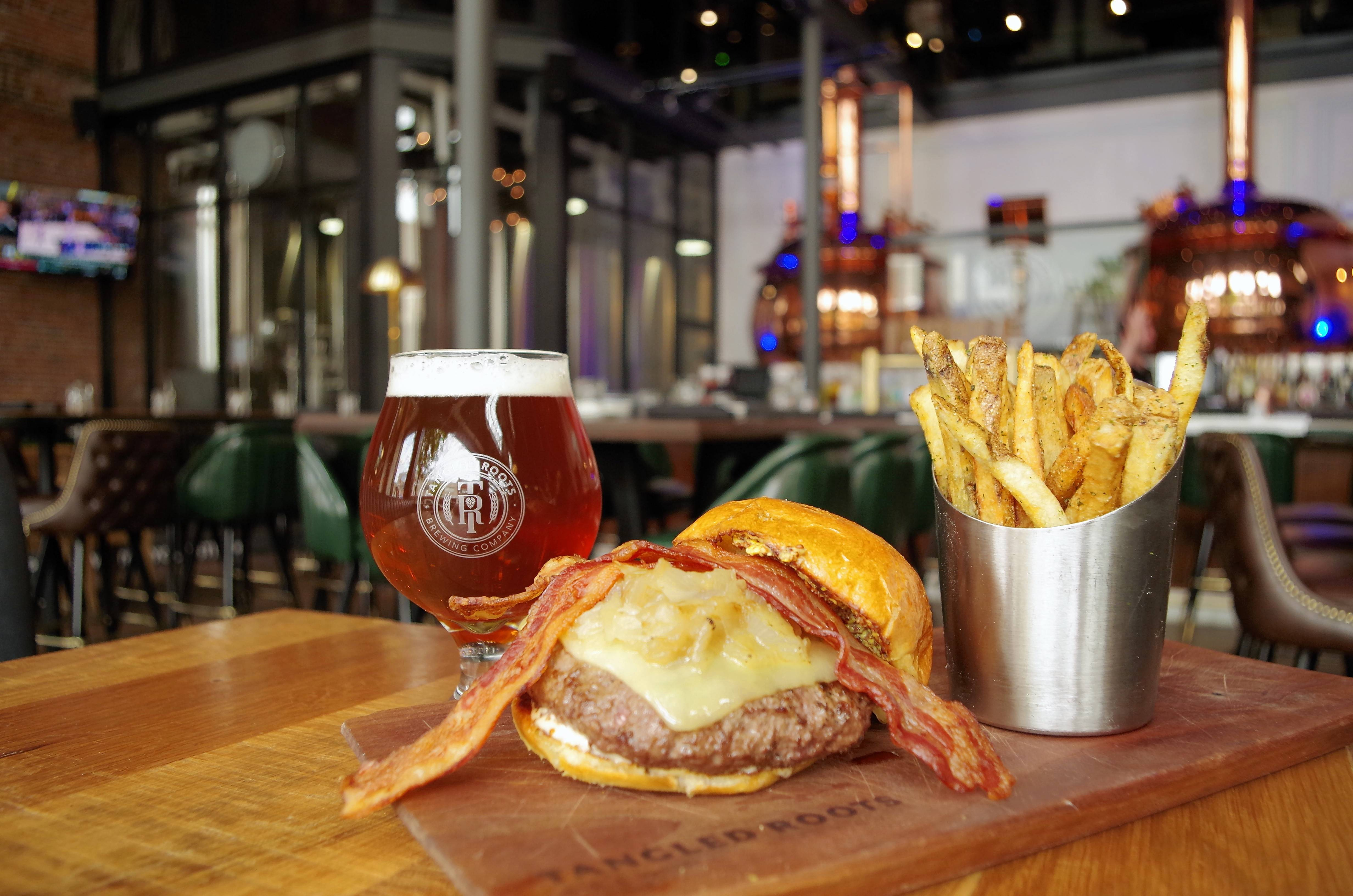 Tangled Roots Brewing Company owns The Lone Buffalo, where diners can get a fantastic burger or a house-made sausage and cheese platter.