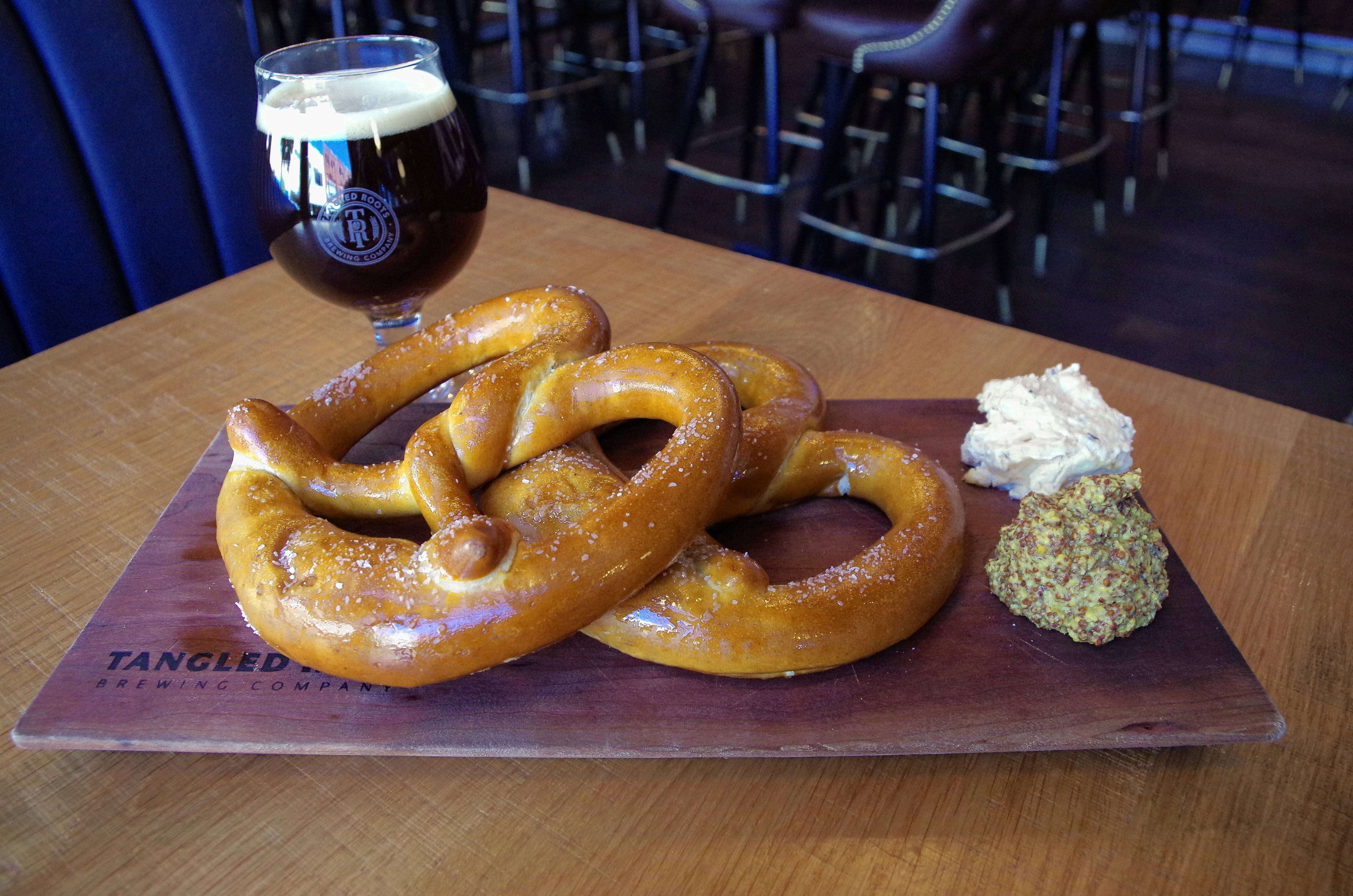 The Lone Buffalo restaurant is part of Tangled Roots Brewing Company in Ottawa, where pretzels are served with house-made obatzda, a Bavarian cheese delicacy.