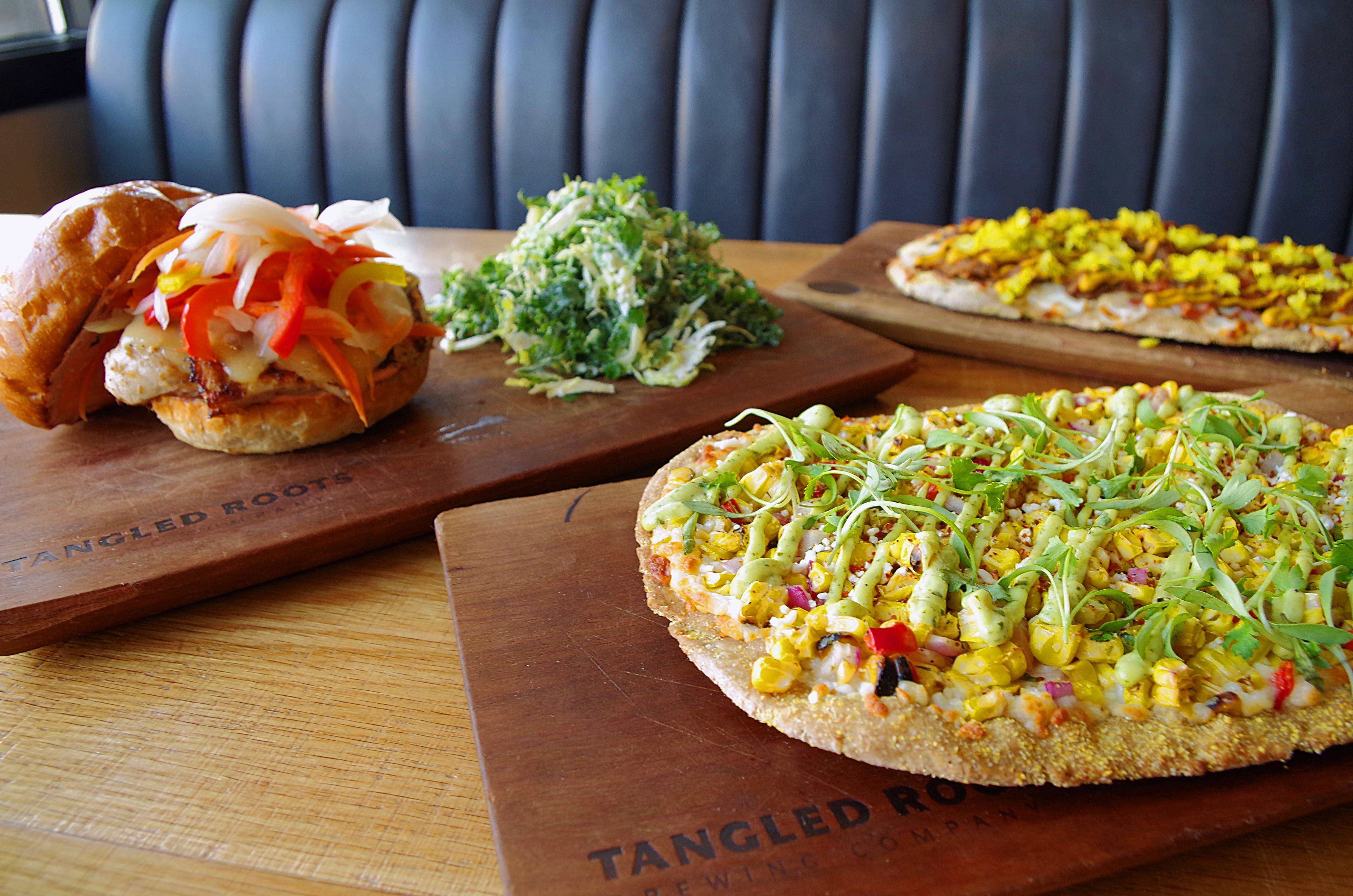 Sandwich and Elote flatbread by Tangled Roots Brewing Company.
