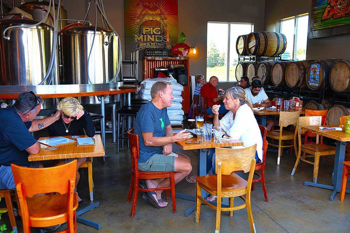 Pig Minds is a brewery and restaurant in Machesney Park, has an industrial look with a rock music backdrop.