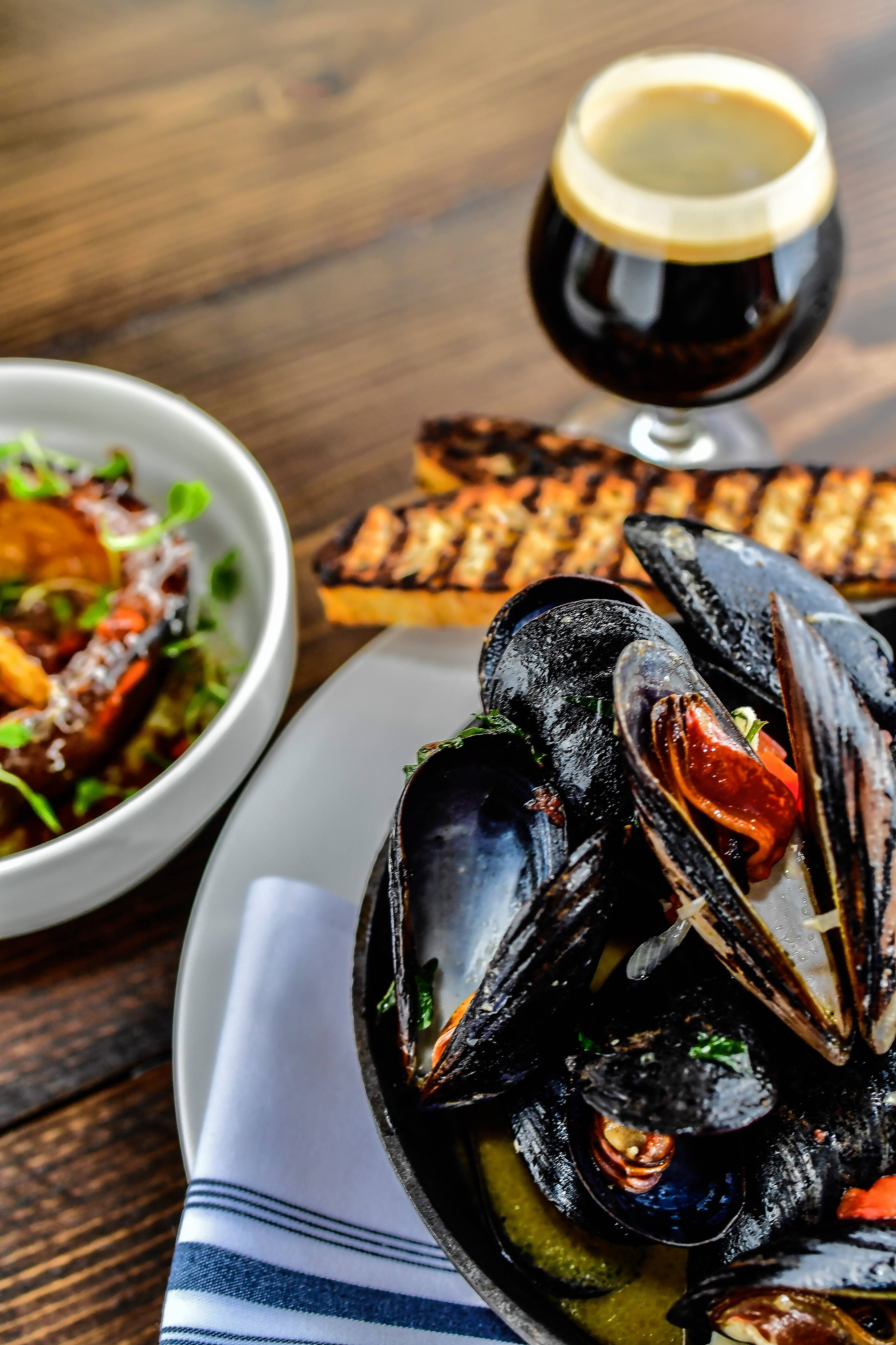 Seafood items such as steamed East Coast black mussels are found on the menu at Old Irving Brewing Co.