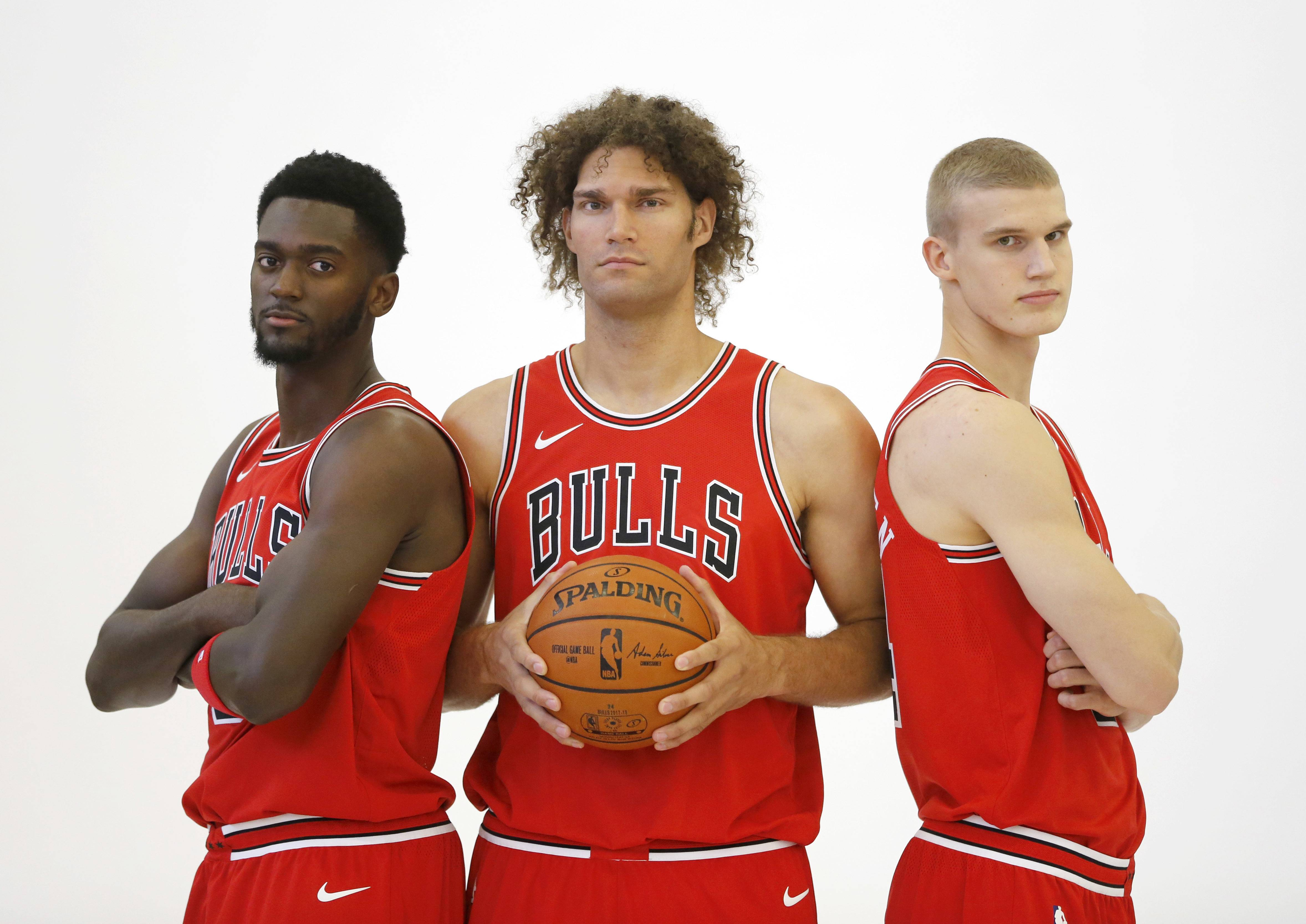 Chicago Bulls' Bobby Portis, left, Robin Lopez, center, and Lauri Markkanen pose for a portrait during media day for the NBA basketball team Monday, Sept. 25, 2017, in Chicago. (AP Photo/Charles Rex Arbogast)