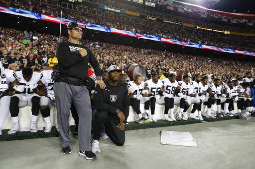 Some members of the Oakland Raiders kneel during the playing of the National Anthem before an NFL football game against the Washington Redskins in Landover, Md., Sunday, Sept. 24, 2017. (AP Photo/Alex Brandon)The Associated Press