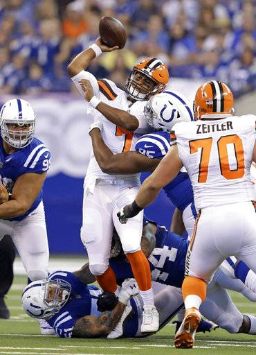 Cleveland Browns quarterback DeShone Kizer (7) is hit as he throws by Indianapolis Colts defensive end Johnathan Hankins (95) during the first half of an NFL football game in Indianapolis, Sunday, Sept. 24, 2017. (AP Photo/Darron Cummings)The Associated Press