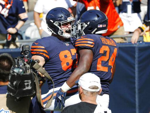 Chicago Bears running back Jordan Howard (24) celebrates his game-winning touchdown with tight end Adam Shaheen (87) in overtime of an NFL football game against the Pittsburgh Steelers, Sunday, Sept. 24, 2017, in Chicago. The Bears won 23-17.