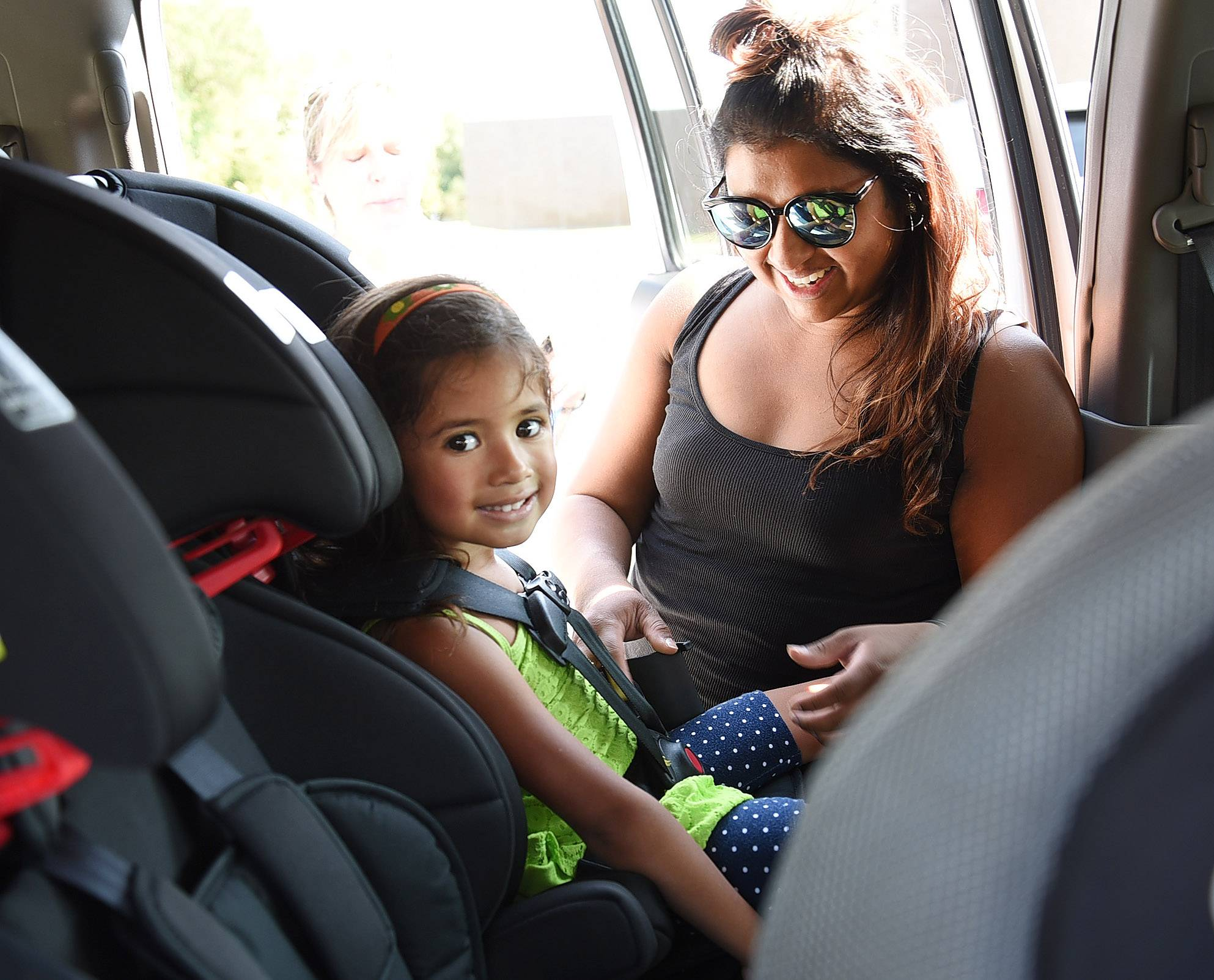 Rita Chavez and her daughter, 4-year-old Samantha, get their car seats inspected by Palatine Police Department Certified Child Safety Seat Inspectors.