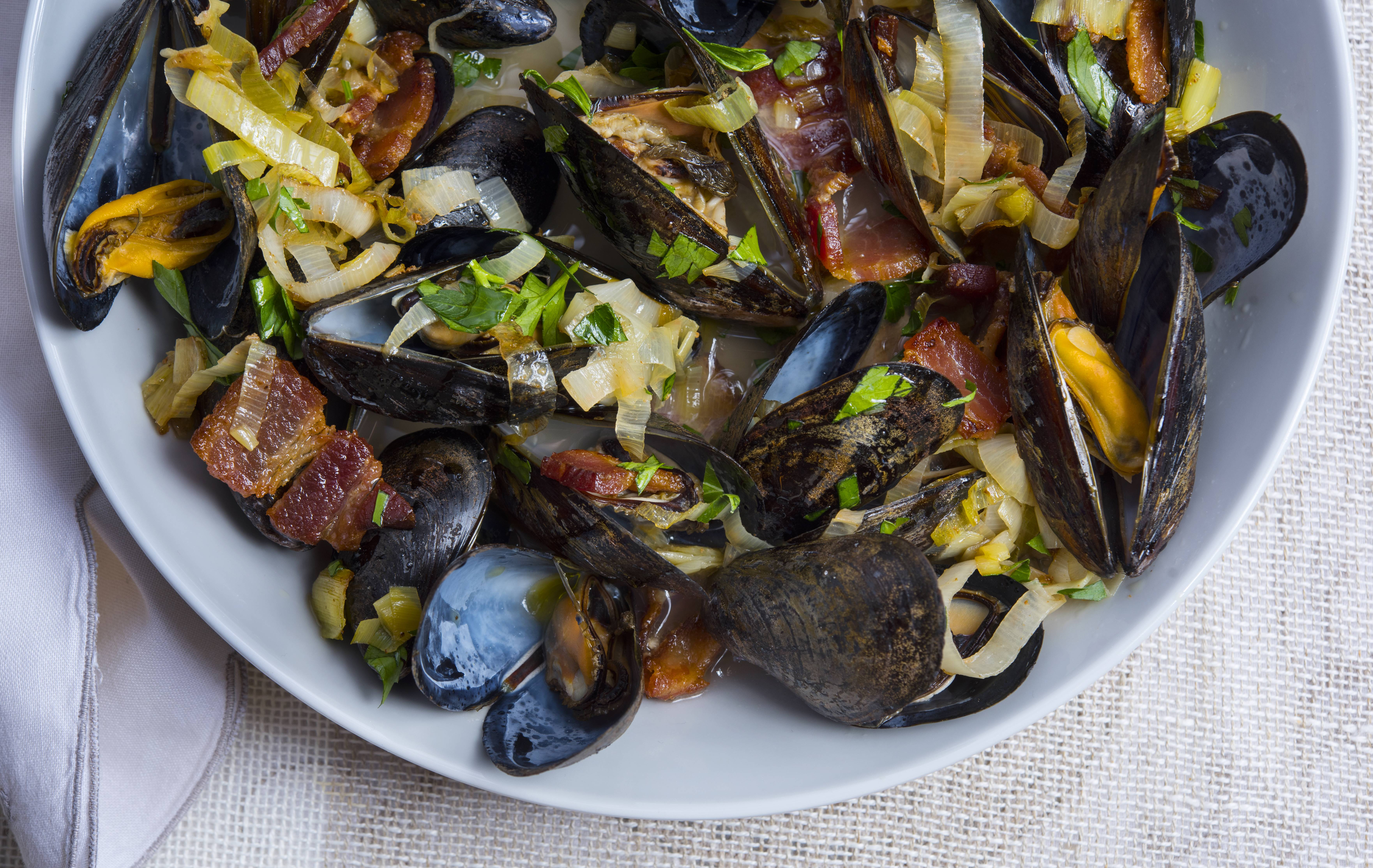 A roasting pan makes a great vessel for cooking a mess o' bivalves like this recipe for Oven-Steamed Mussels. While they're in a high-heat oven, the sauce comes together in a skillet on the stove.