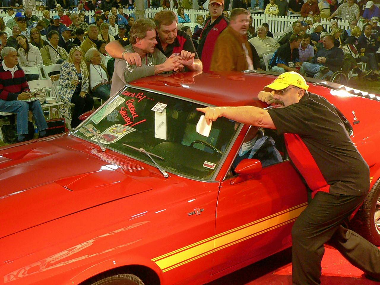 A sure place to find Dana Mecum at the auctions is right in the thick of the action. In this image from an early Mecum event, a rare 1970 Shelby GT500 Mustang crosses the block.