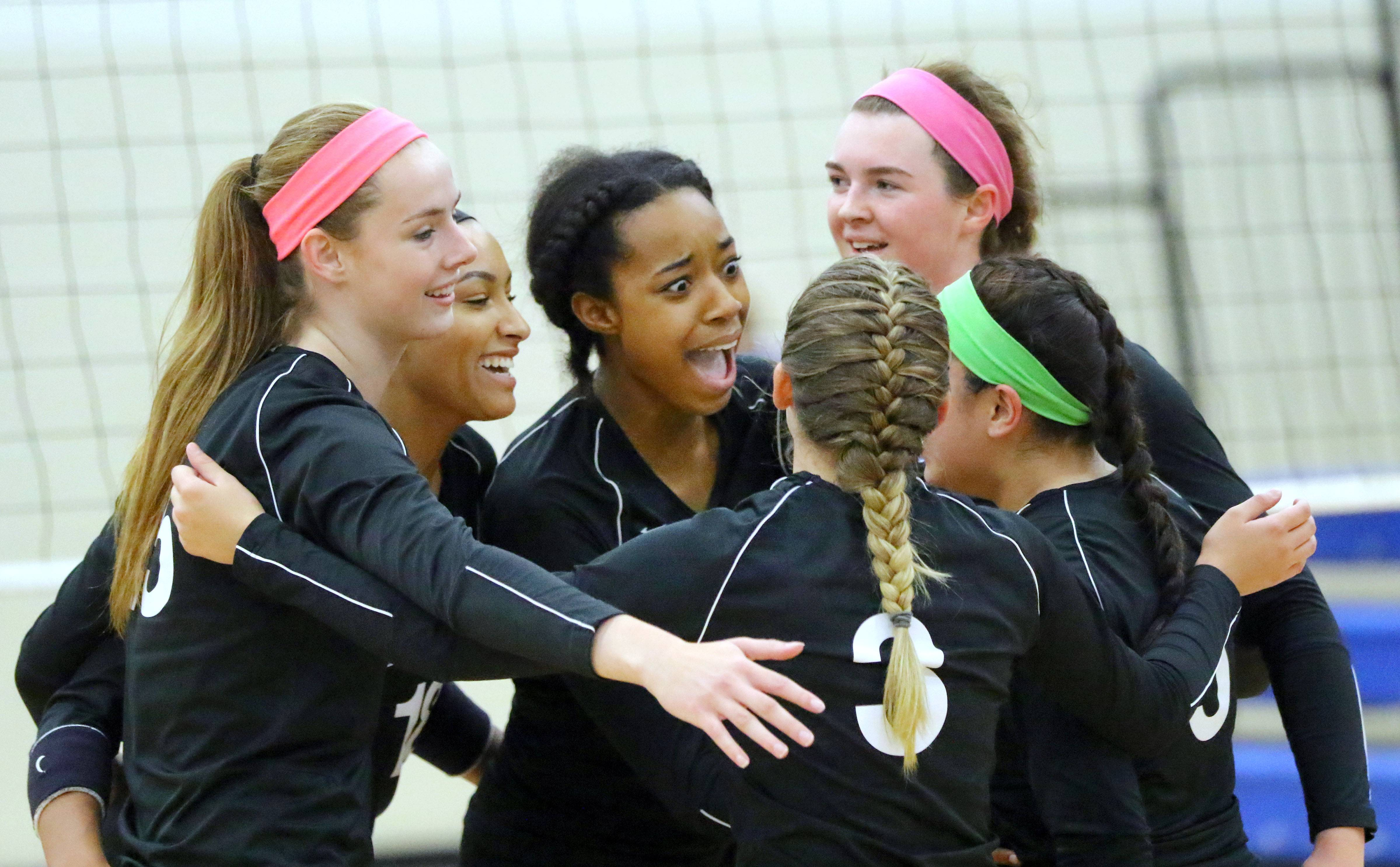 Lakes' players celebrate during their game against Grant Tuesday night at Lakes High School in Lake Villa.