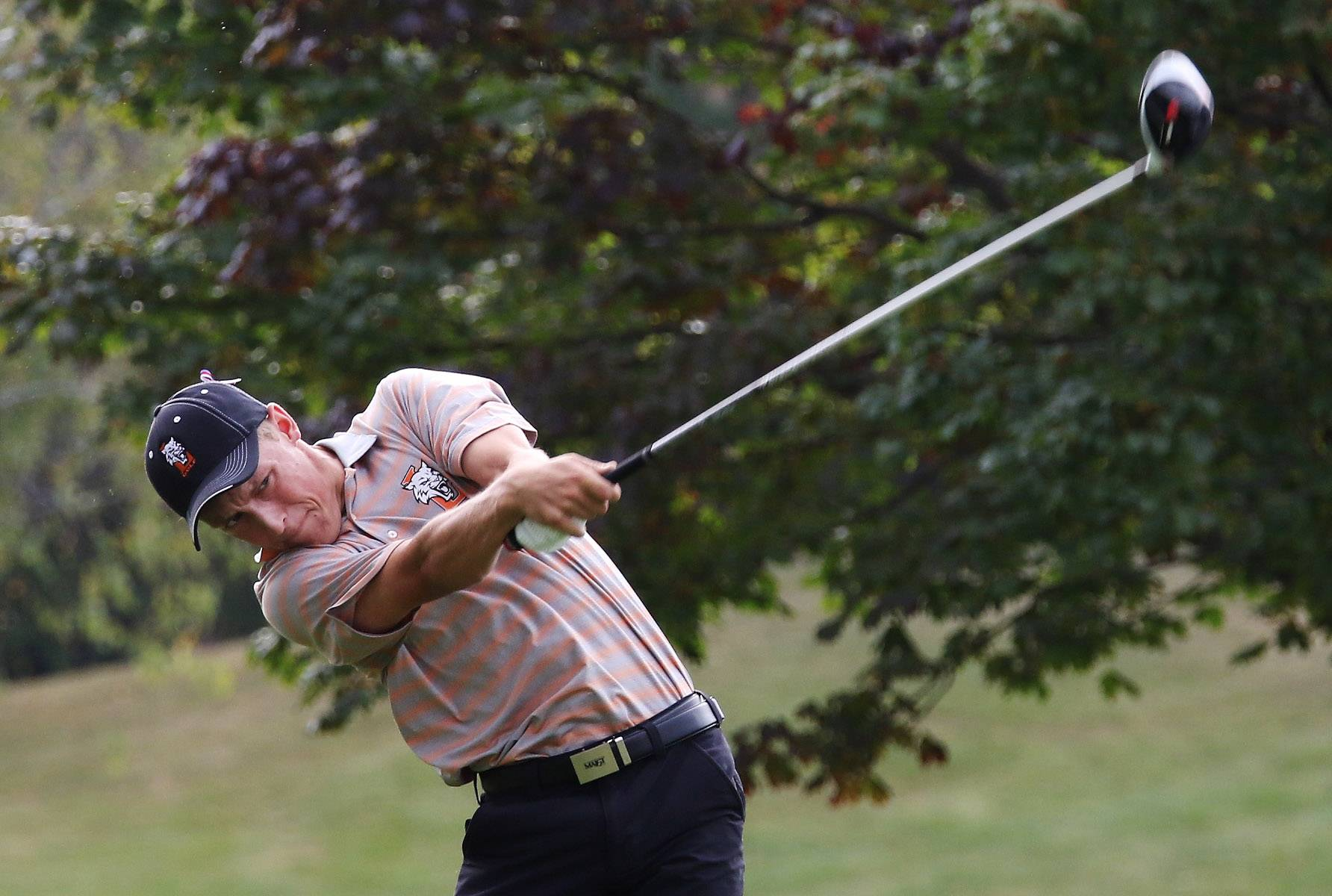 Libertyville's Mitch Kenston tees off on the second hole during the North Suburban Conference tournament Tuesday at Willow Glen Golf Course in North Chicago.