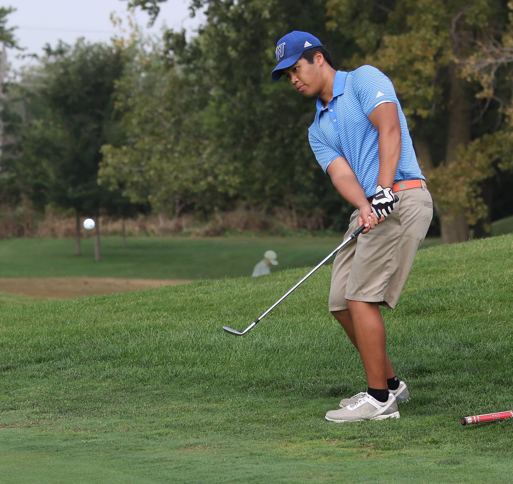 Warren's Karl Tolentino hits onto the green on the 14th hole during the North Suburban Conference tournament on Tuesday at Willow Glen Golf Course in North Chicago.