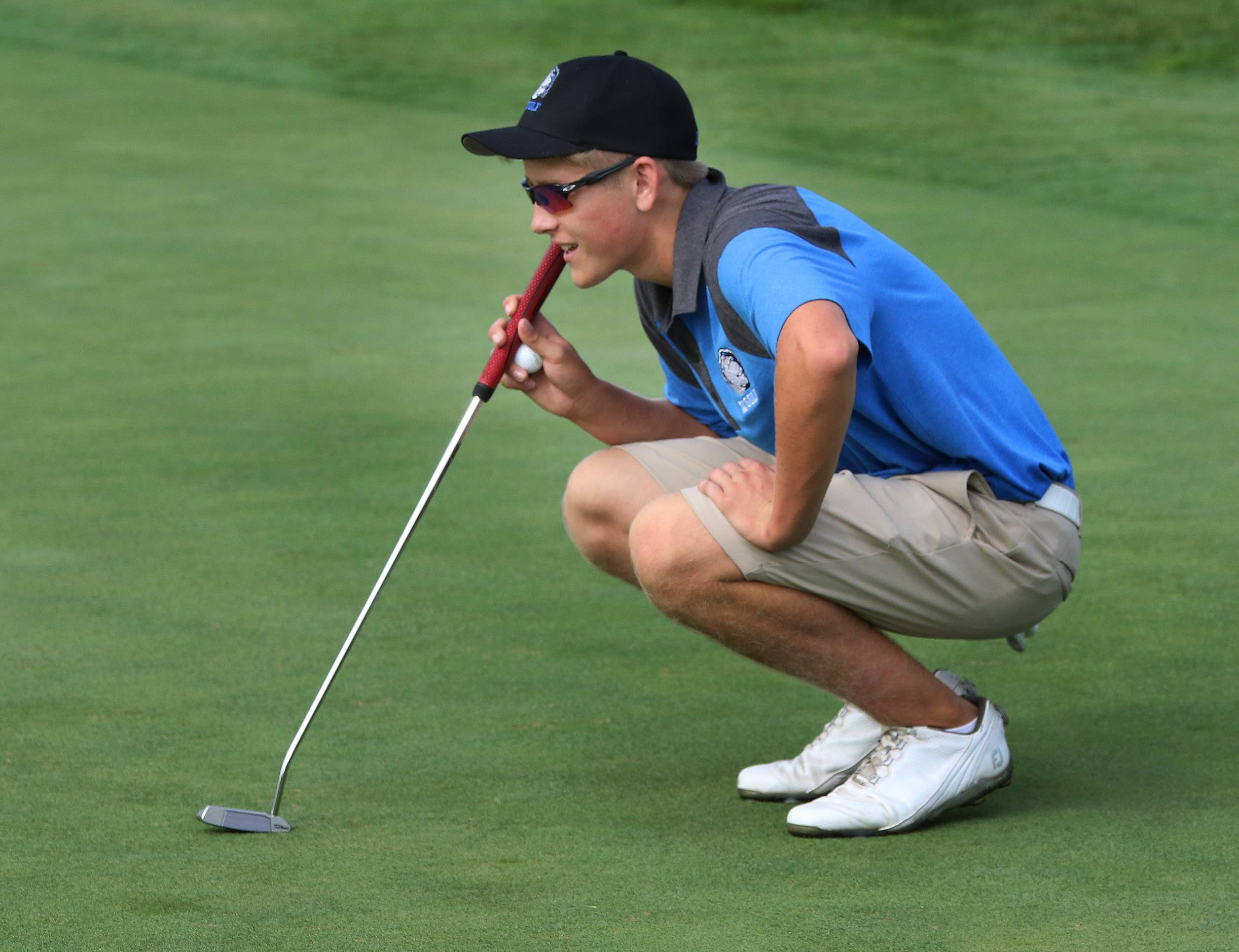 Lake Zurich's Konnor Kininmonth lines up his putt on the 14th hole during the North Suburban Conference tournament on Tuesday at Willow Glen Golf Course in North Chicago.