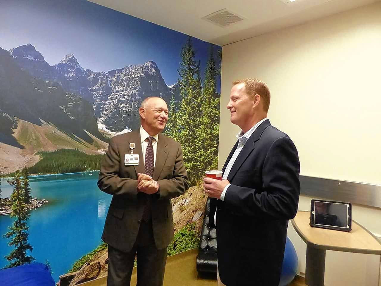 At left, Steve Scogna, Northwest Community Healthcare president and CEO, talks to donor Chris Dungan of Arlington Heights as they take in the serene comforts of one of two new sensory rooms in the Northwest Community Hospital Emergency Department.