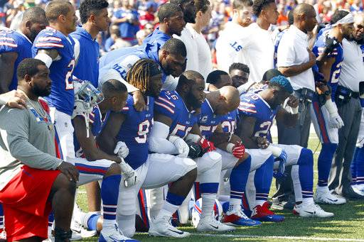 FILE - In this Sunday, Sept. 24, 2017, file photo, Buffalo Bills players take a knee during the playing of the national anthem prior to an NFL football game against the Denver Broncos in Orchard Park, N.Y. What began more than a year ago with a lone NFL quarterback protesting police brutality against minorities by kneeling silently during the national anthem before games has grown into a roar with hundreds of players sitting, kneeling, locking arms or remaining in locker rooms, their reasons for demonstrating as varied as their methods.