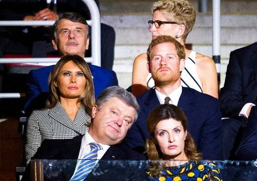 Britain's Prince Harry, middle row right, takes in the opening ceremonies of the Invictus Games in Toronto on Saturday, Sept. 23, 2017. Front row from left, Petro Poroshenko, President of Ukraine, Maryna Poroshenko, first lady of Ukraine, middle row from left, Melania Trump, first lady of the United States, and Prince Harry, back row from left, Dr. Ralf Speth, CEO Jaguar Land Rover, and Kathleen Wynne, Premier of Ontario. (Nathan Denette/The Canadian Press via AP)