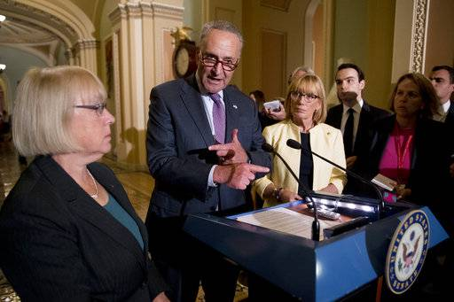 Senate Minority Leader Sen. Chuck Schumer of N.Y., accompanied by Sen. Patty Murray, D-Wash., left, and Sen. Jeanne Shaheen, D-N.H., right, speaks to reporters as Senate Republicans faced defeat on the Graham-Cassidy bill, the GOP's latest attempt to repeal the Obama health care law, at the Capitol in Washington, Tuesday, Sept. 26, 2017, in Washington. The decision marked the latest defeat on the issue for President Donald Trump and Senate Majority Leader Mitch McConnell in the Republican-controlled Congress.