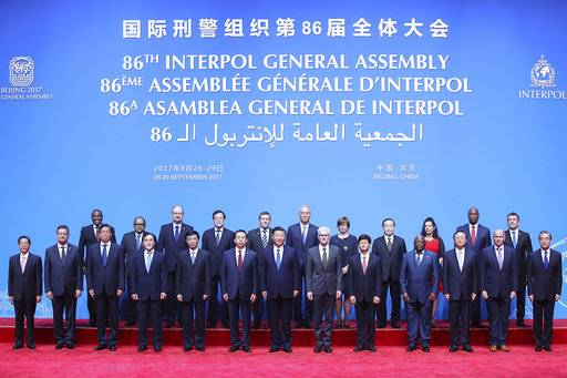 Chinese President Xi Jinping, front center, poses with Secretary General of Interpol Jurgen Stock, sixth from right, and President of Interpol Meng Hongwei, sixth from left, for a group photo before the 86th Interpol General Assembly at Beijing National Convention Center in Beijing, Tuesday, Sept. 26, 2017. (Lintao Zhang/Pool Photo via AP)