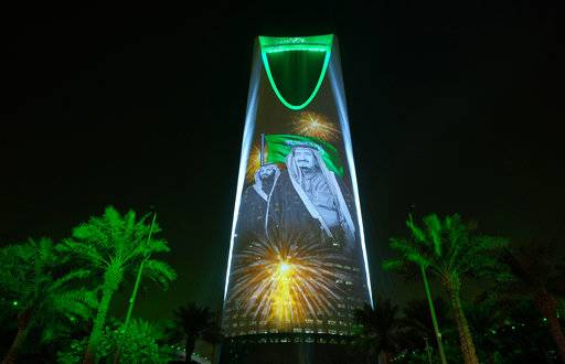 "In this Sunday, Sept. 24, 2017 photo released by the Saudi Culture and Information Ministry, the image of King Salman and Crown Prince Mohammed bin Salman are projected on the Kingdom Tower during National Day ceremonies in Riyadh, Saudi Arabia. A new 62-page report by Human Rights Watch finds that despite Saudi Arabia's recent efforts toward reform, some state-backed clerics continue to ""incite hatred and discrimination against religious minorities"" while text books stigmatize minorities, particularly Muslim Shiites. (Saudi Culture and Information Ministry via AP)"