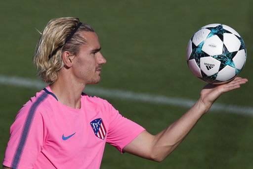 Atletico's Antoine Griezmann holds a ball in the air during a training session in Madrid, Spain, Tuesday, Sept. 26, 2017. Atletico will play Chelsea Wednesday in a Group C Champions League soccer match.