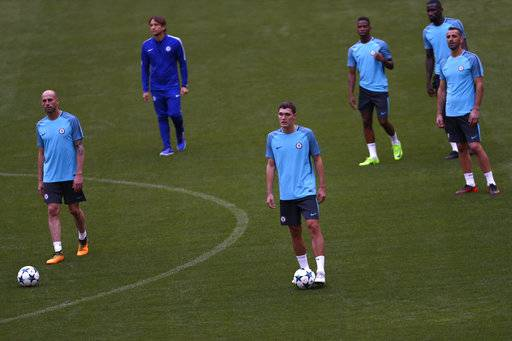Chelsea's players walk along the pitch during a media opportunity at the Metropolitano stadium in Madrid, Tuesday, Sept. 26, 2017.  Atletico Madrid will play a Champions League Group C soccer match with Chelsea on Wednesday.