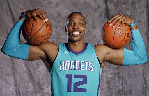Charlotte Hornets' Dwight Howard poses for a photo during the NBA basketball team's media day in Charlotte, N.C., Monday, Sept. 25, 2017. The Hornets are banking on Dwight Howard to help them get back to the playoffs after a disappointing season a year ago.