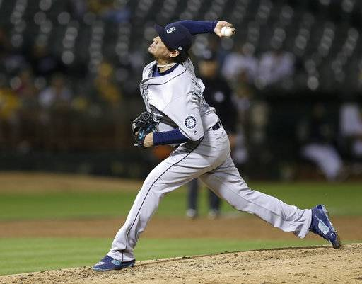 Seattle Mariners pitcher Felix Hernandez works against the Oakland Athletics during the third inning of a baseball game Monday, Sept. 25, 2017, in Oakland, Calif. (AP Photo/Ben Margot)