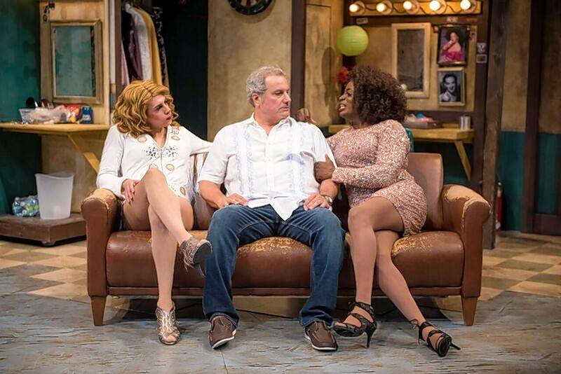 "Bar owner Eddie (Keith Kupferer), center, chats with his new headliners Miss Tracy Mills (Sean Blake), right, and Rexy (Jeff Kurysz) in ""The Legend of Georgia McBride"" at Northlight Theatre."