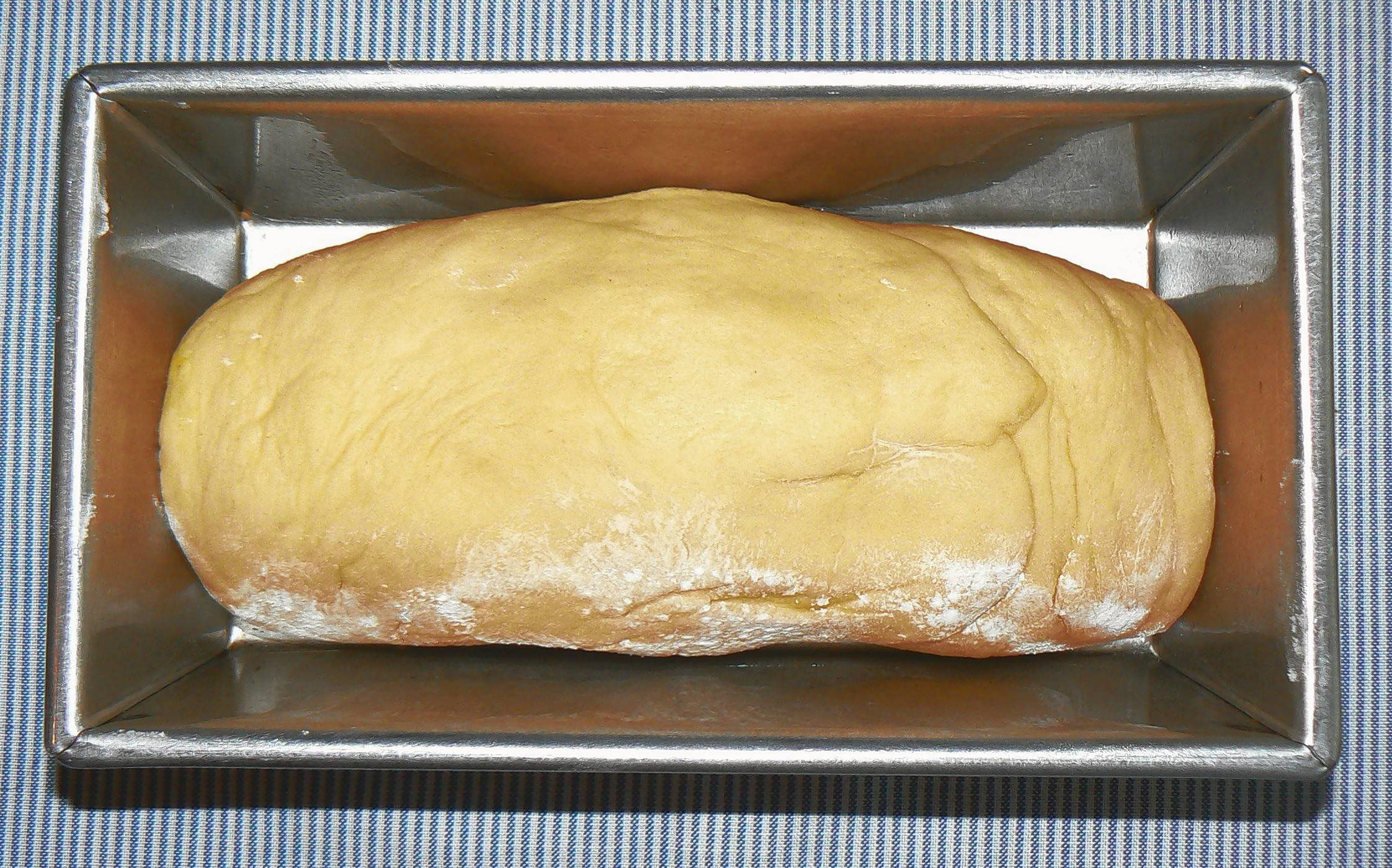 After the bread rises, briefly knead and let it rise for the second time.