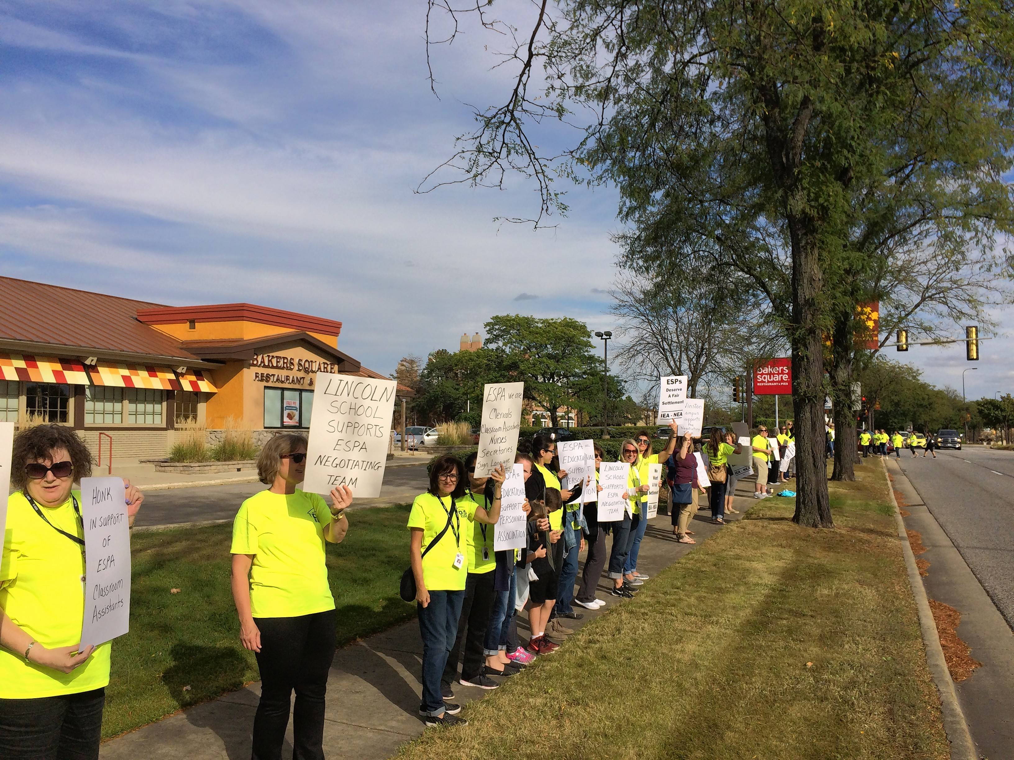 Palatine Township Elementary District 15 secretaries, nurses and other support employees showed their displeasure over stalled contract negotiations in a Wednesday afternoon rush-hour picket off Northwest Highway in the village.
