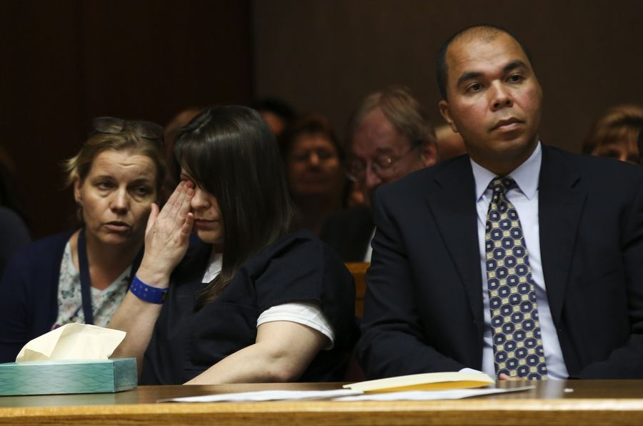 Elzbieta Plackowska, center, of Naperville, listens to an interpreter with First Deputy Public Defender George Ford during closing arguments Wednesday in her trial for killing her 7-year-old son and a 5-year-old girl she was baby-sitting. A DuPage County judge found her guilty of 10 counts of first-degree murder.