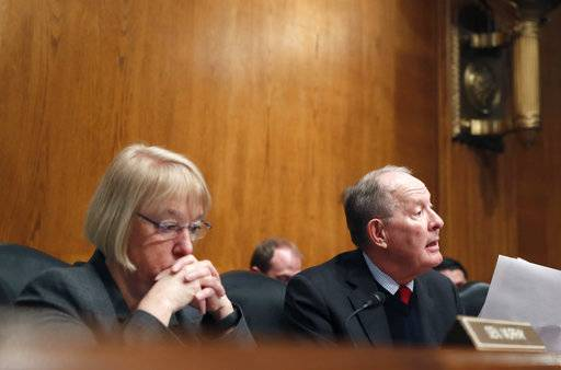 FILE- In this Jan. 31, 2017, file photo, Senate Health, Education, Labor, and Pensions Committee Chairman Sen. Lamar Alexander, R-Tenn., accompanied by the committee's ranking member Sen. Patty Murray, D-Wash. speaks on Capitol Hill in Washington during the committee's executive session to discuss the nomination of Education Secretary Betsy DeVos. Congress is at a crossroads after Senate GOP leaders announced on Tuesday, Sept. 26, that they would not take their latest repeal of Barack Obama's health care law bill to the floor for lack of support. Alexander said he would resume efforts to reach a bipartisan deal with Murray to stabilize markets for individual insurance policies that 18 million people rely on.