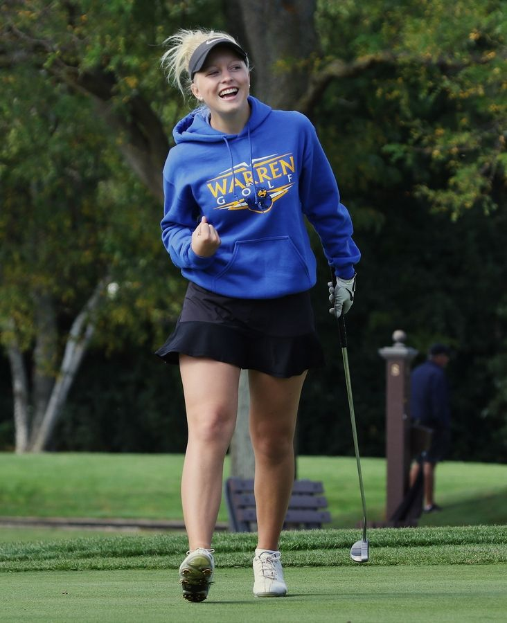Warren's Annika Johnson celebrates her birdie on the seventh hole during the North Suburban Conference tournament Wednesday at Bonnie Brook Golf Course in Waukegan.