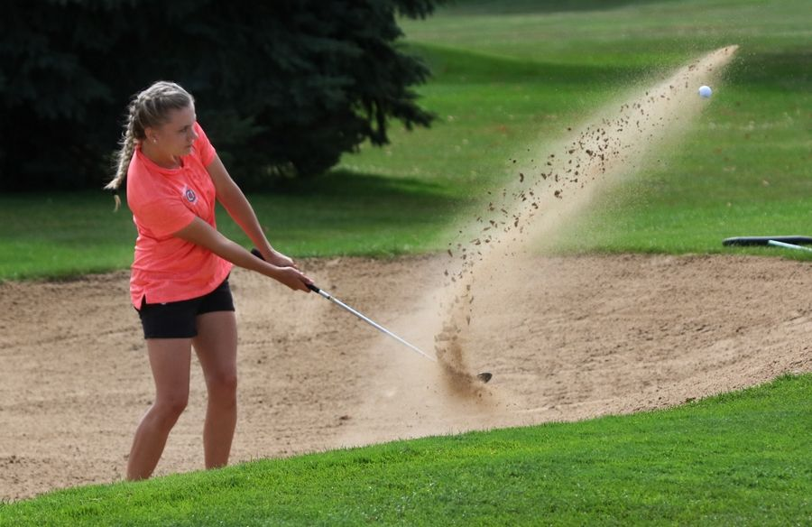 Libertyville golfer Colby Roberts hits out of the sand trap on the 16th hole during the North Suburban Conference tournament Wednesday at Bonnie Brook Golf Course in Waukegan.