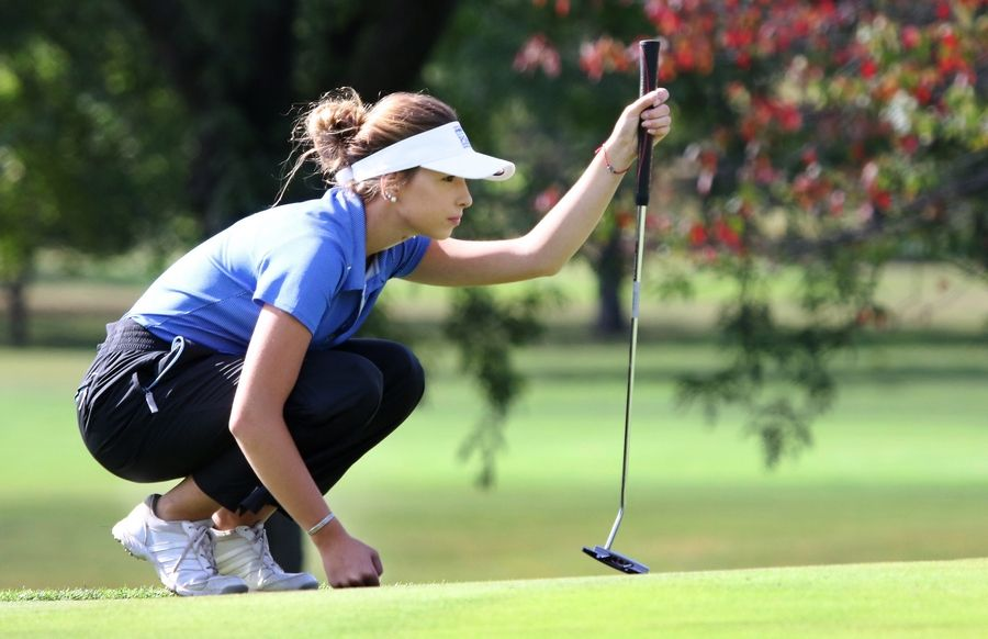 Warren's  Chloe Morrissey lines up her putt on the seventh hole during the North Suburban Conference tournament Wednesday at Bonnie Brook Golf Course in Waukegan.