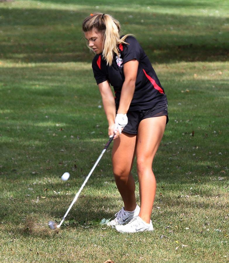 Mundelein's Maddie Wade strikes the ball on the 15th hole during the North Suburban Conference tournament Wednesday at Bonnie Brook Golf Course in Waukegan.