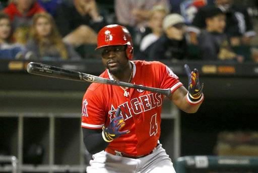 Los Angeles Angels' Brandon Phillips lets go of his bat as he takes the first pitch from Chicago White Sox starting pitcher Reynaldo Lopez for a ball during the sixth inning of a baseball game Wednesday, Sept. 27, 2017, in Chicago.