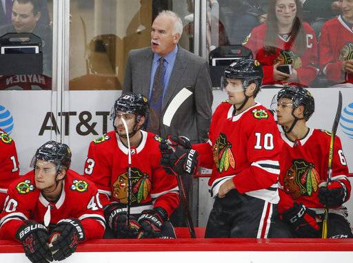 Chicago Blackhawks head coach Joel Quenneville, top center, yells to his team during the third period of a preseason NHL hockey game against the Columbus Blue Jackets Saturday, Sept. 23, 2017, in Chicago.