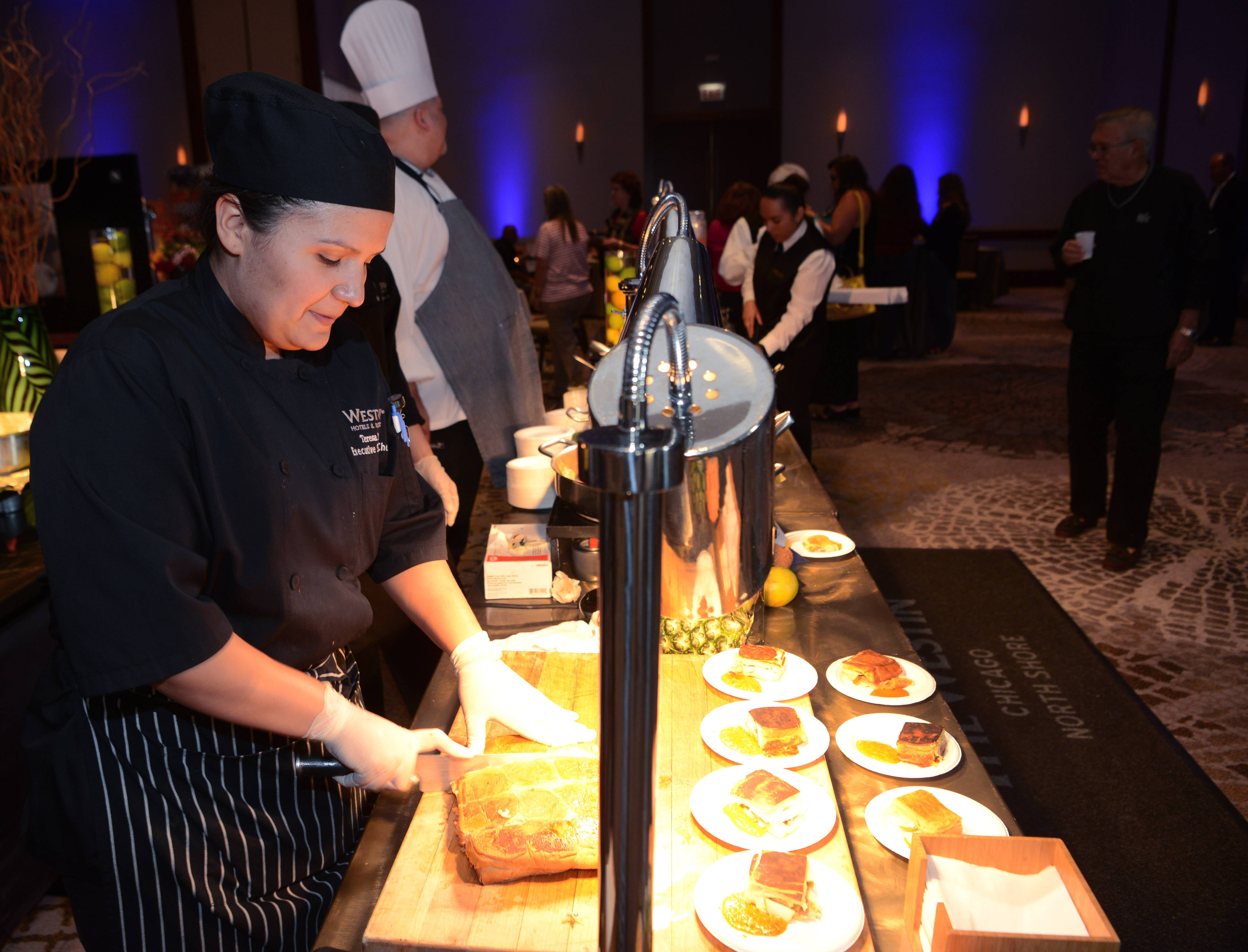 Teresa Ruiz, executive sous chef at Westin Hotels and Resort, cuts media niche sliders during Wheeling's Taste of the Town, held at The Westin Chicago North Shore in Wheeling Thursday.