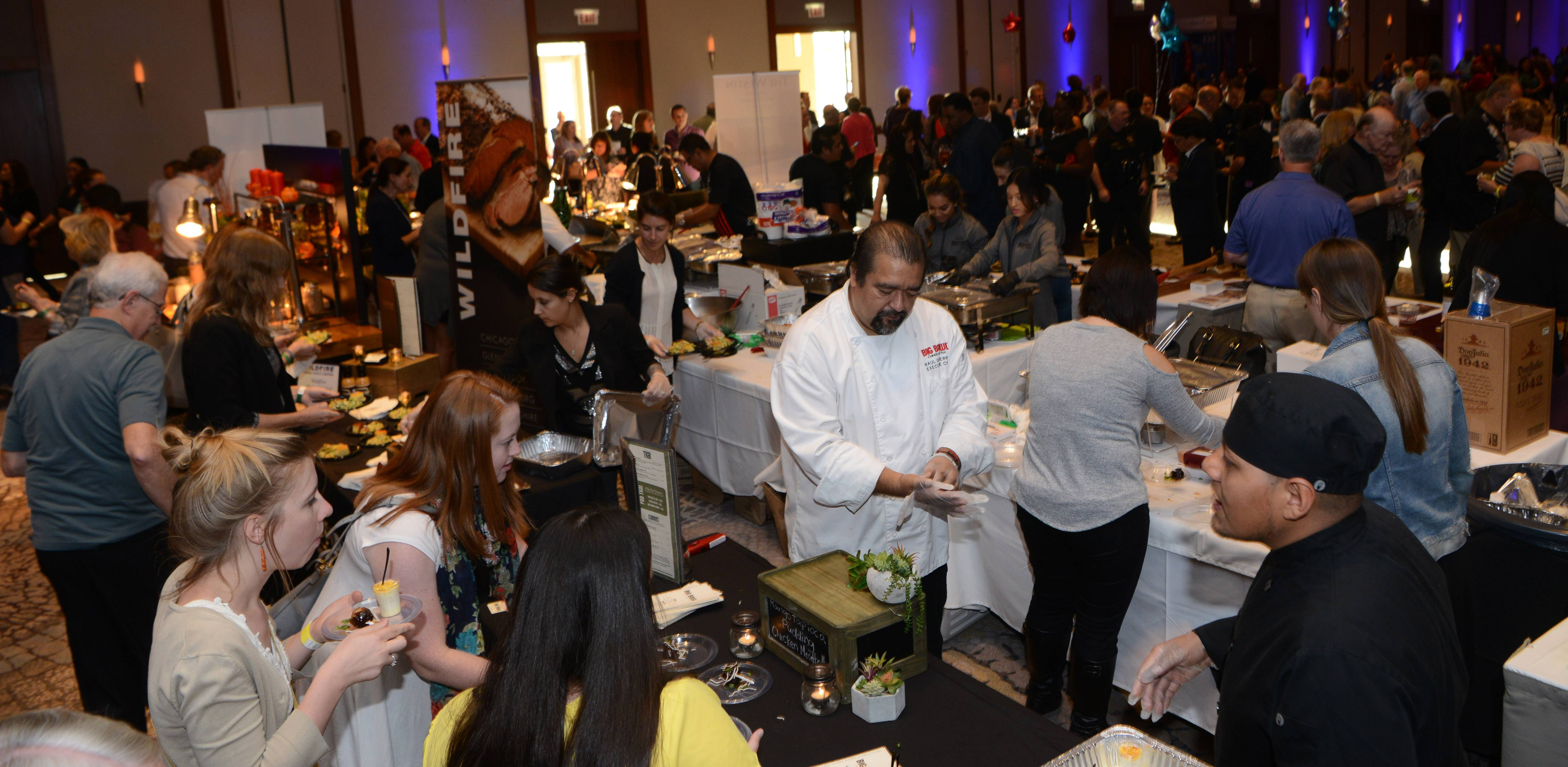 Restaurants offer a variety of dishes and drinks during Wheeling's Taste of the Town, held at The Westin Chicago North Shore in Wheeling Thursday.