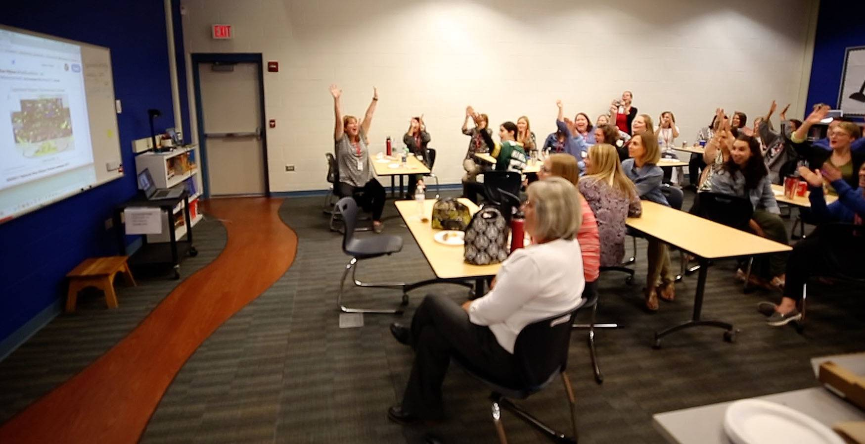 Copeland Manor School teachers cheer Thursday as they watch a video from the U.S. Department of Education announcing the Libertyville school is among the 2017 National Blue Ribbon School Award winners.