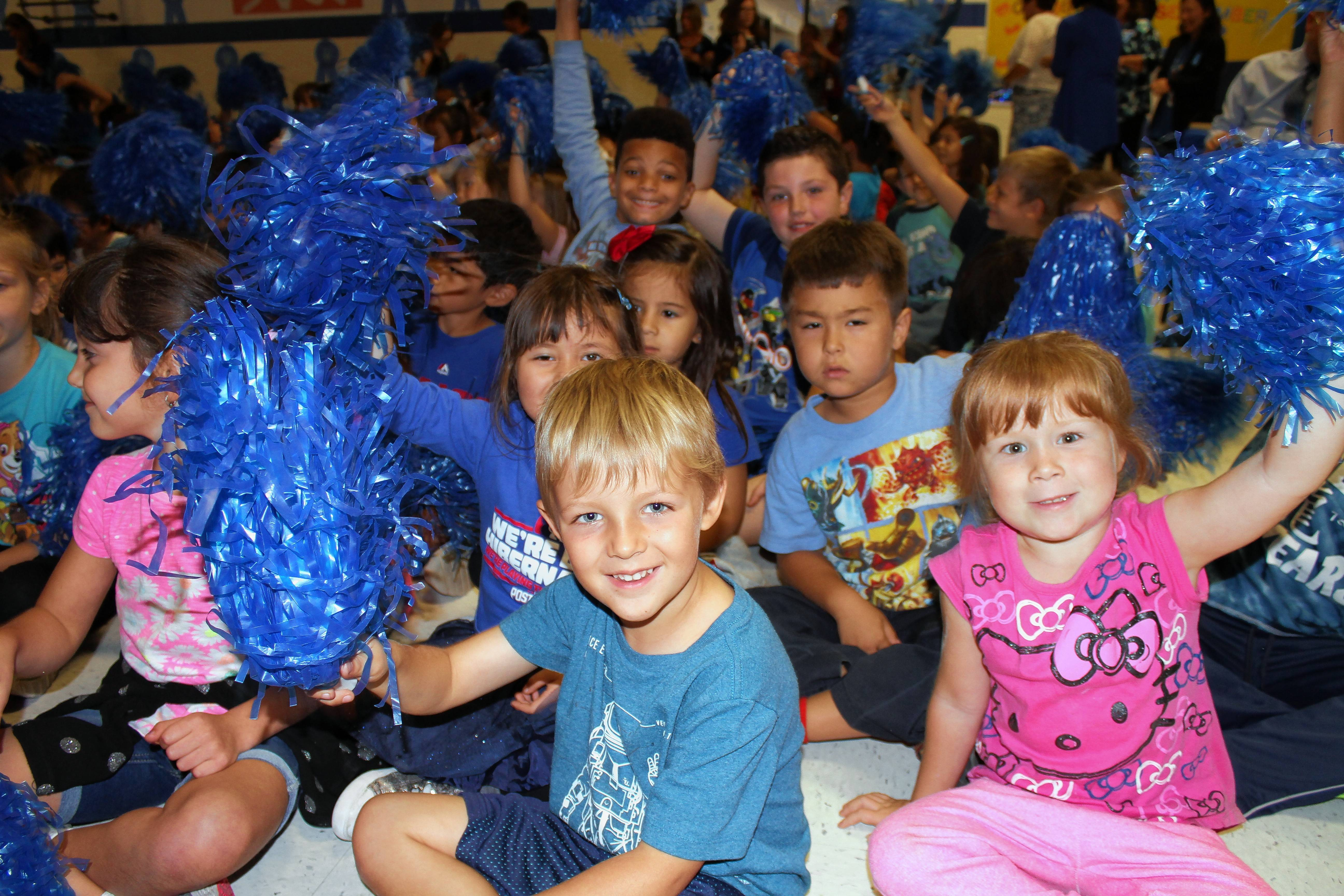 Students at Thomas Dooley Elementary School in Schaumburg celebrate its being named a 2017 National Blue Ribbon School during an all-school assembly Thursday afternoon.