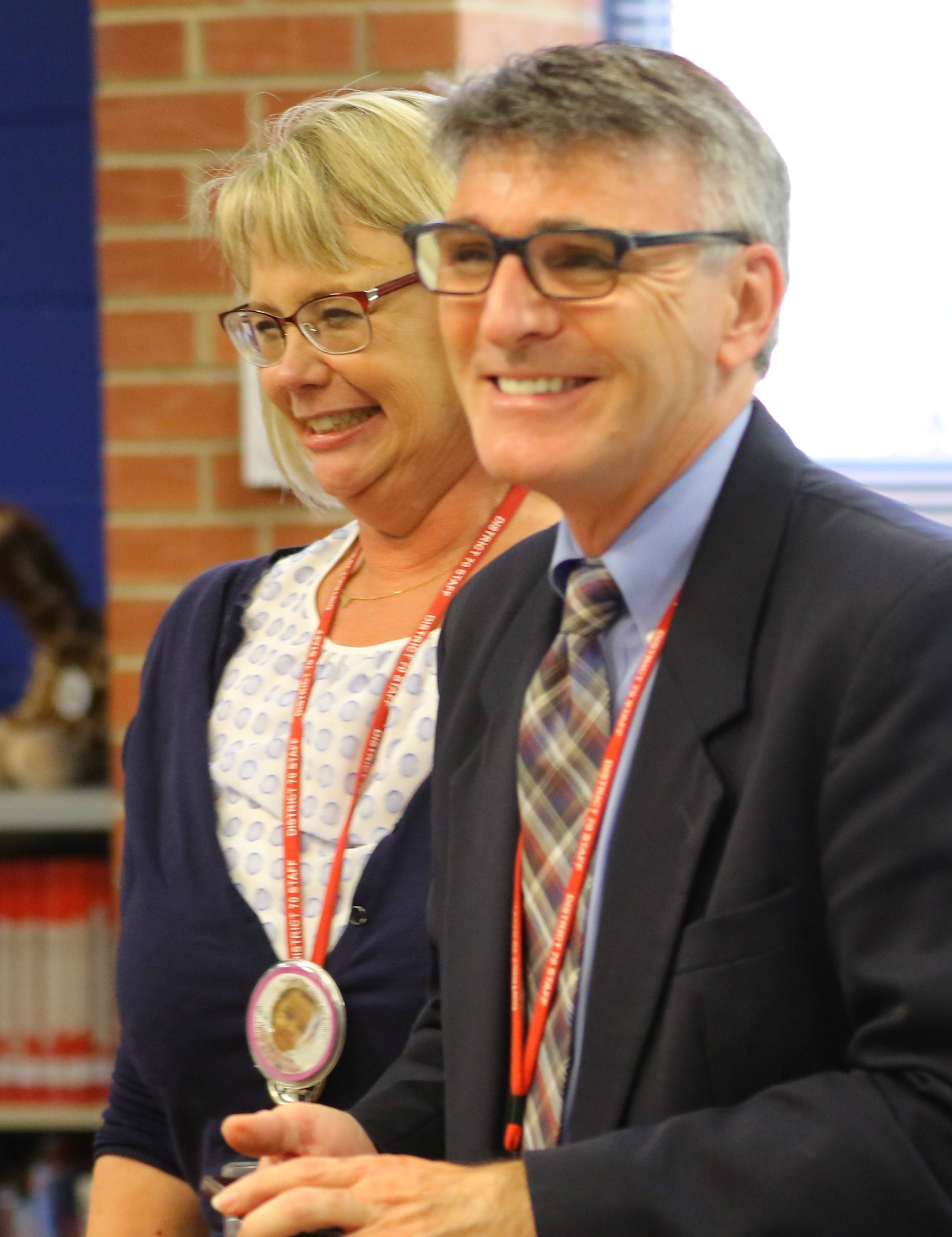 Copeland Manor School Principal Lori Poelking, left, and Libertyville Elementary District 70 Superintendent Guy Schumacher smile Thursday after hearing the school is among those being honored by the U.S. Department of Education as a 2017 National Blue Ribbon School Award winner.