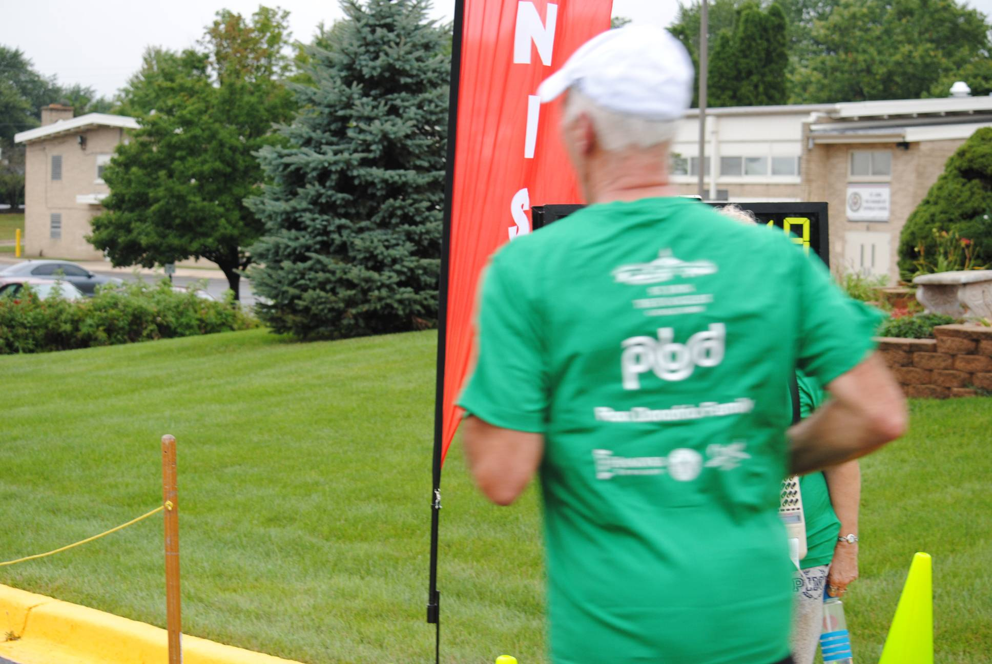 Race Director, Jim Kaltinger, crossing the finish line in 2016 Knights Challenge 5K - St. John the Evangelist Church, Streamwood, IL. 8/27/16Gary Pappin