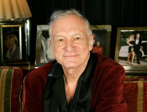 FILE - In this April 7, 2006 file photo, Playboy founder Hugh Hefner is photographed at the Playboy Mansion in the Holmby Hills area of Los Angeles. Hefner has died at age 91. The magazine released a statement saying Hefner died at his home of natural causes Wednesday night, Sept. 27, 2017, surrounded by family.
