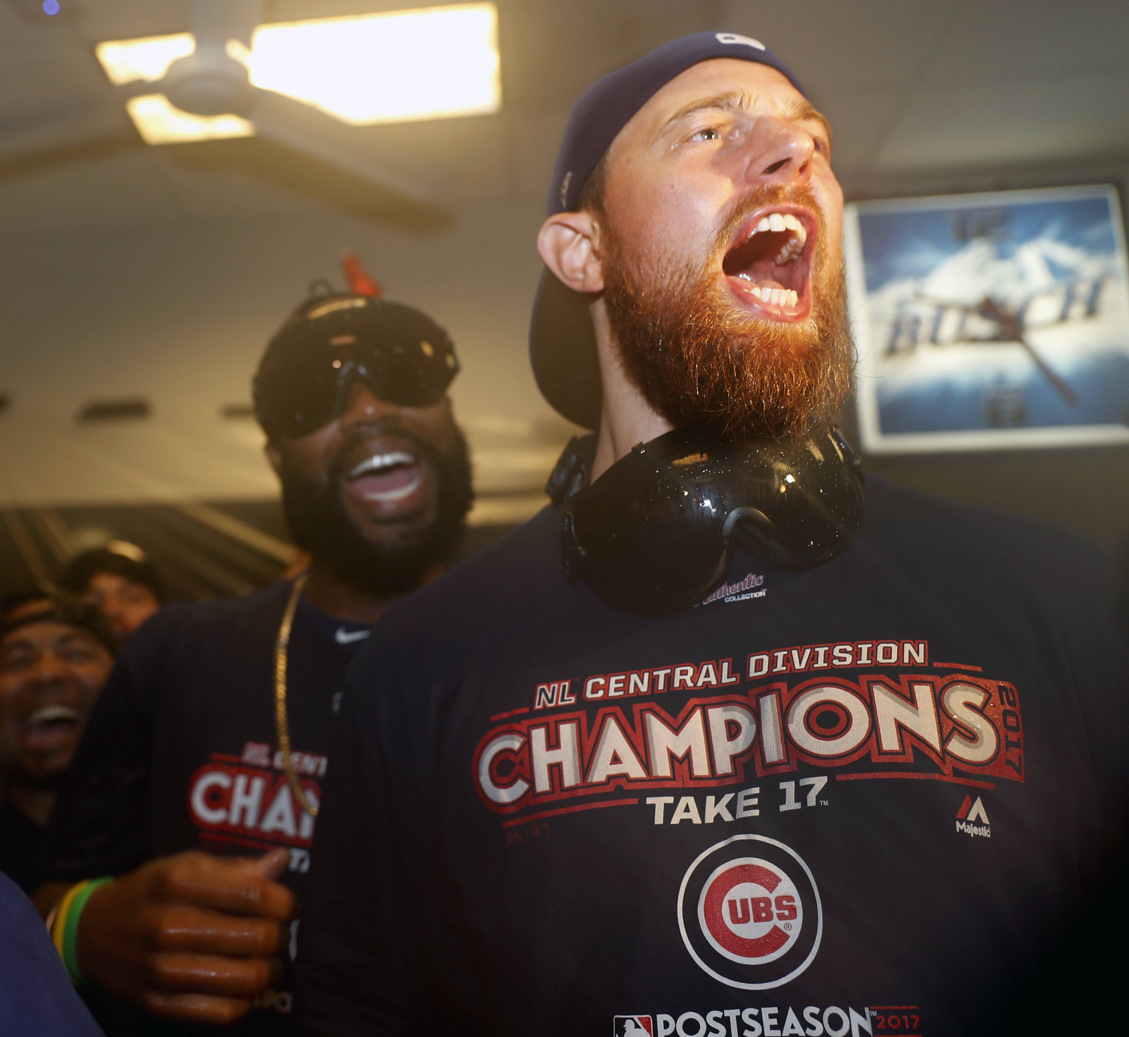 Cubs' Ben Zobrist, right, and Jason Heyward celebrate with teammates after beating the St. Louis Cardinals to clinch the National League Central title Wednesday. What was the biggest lesson from the Chicago Cubs winning the National League Central? According to Daily Herald Cubs writer Bruce Miles, it's that the long view is most important in baseball.
