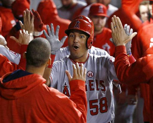 Los Angeles Angels' Carlos Perez (58) celebrates his two-run home run off Chicago White Sox starting pitcher Dylan Covey during the fifth inning of a baseball game Thursday, Sept. 28, 2017, in Chicago.