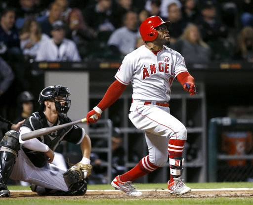Los Angeles Angels' Eric Young Jr. watches his RBI ground-rule double off Chicago White Sox starting pitcher Dylan Covey during the fifth inning of a baseball game Thursday, Sept. 28, 2017, in Chicago.