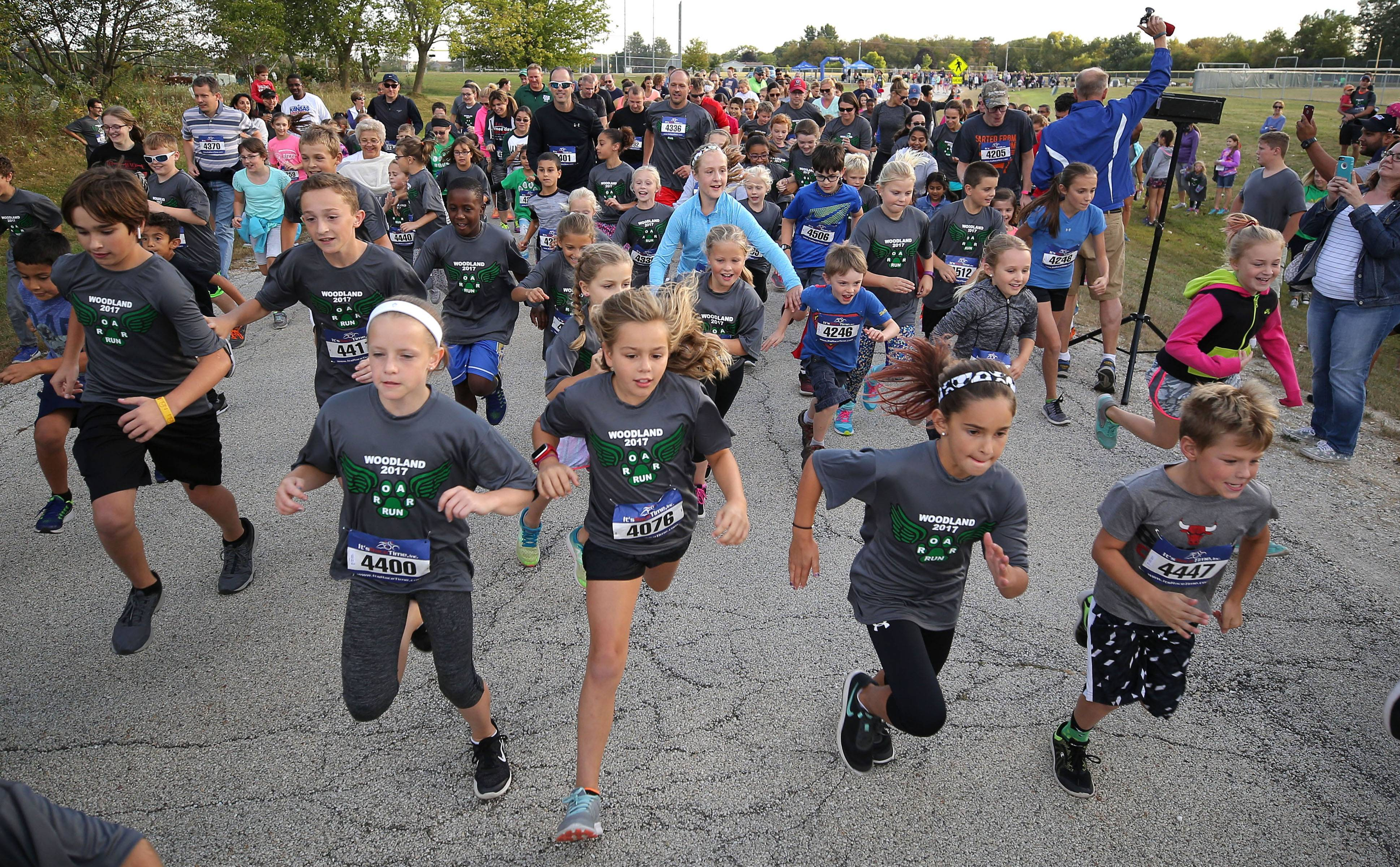 Kids dart off the starting line in a one-mile race Friday during the ROAR Run sponsored by the Woodland PTA at Woodland Middle School in Gurnee.